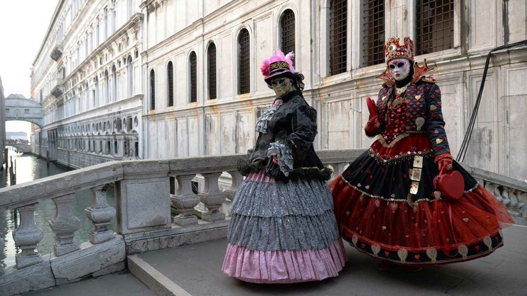 Traditional costumes and masks during Venice Carnival